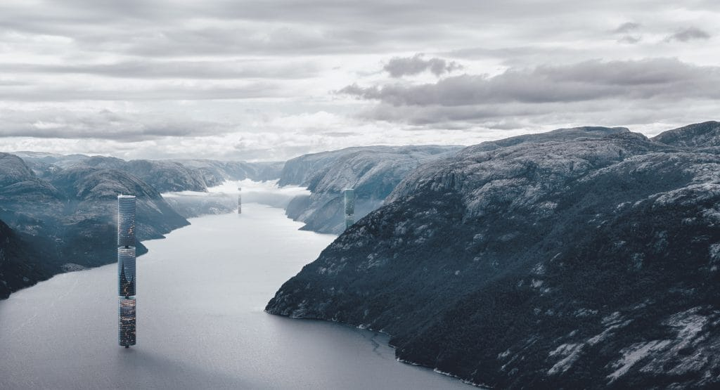 A wide angle view of futuristic towers between the fjord